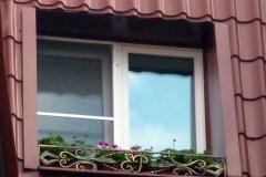 Кованая решетка для цветов на окно
